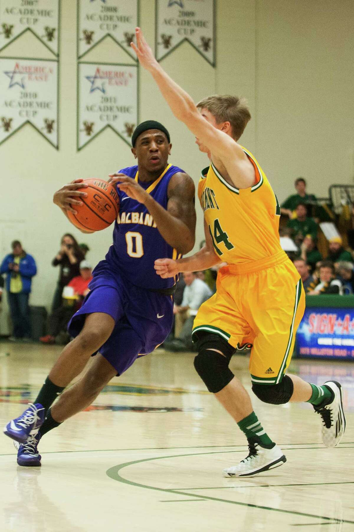UAlbany guard Evan Singletary drives to the basket past Vermont guard Cam Ward during their men's basketball game at Patrick Gym on Wednesday, Jan. 28, 2015, in Burlington, Vt. (Brian Jenkins / Special to the Times Union)
