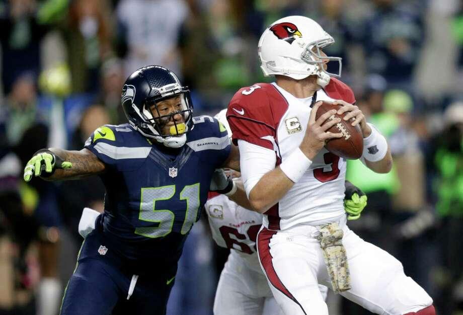 Seattle Seahawks outside linebacker Bruce Irvin pressures Arizona Cardinals quarterback Carson Palmer during the first half of an NFL football game, Sunday, Nov. 15, 2015, in Seattle. Photo: Stephen Brashear, Associated Press / FR159797 AP