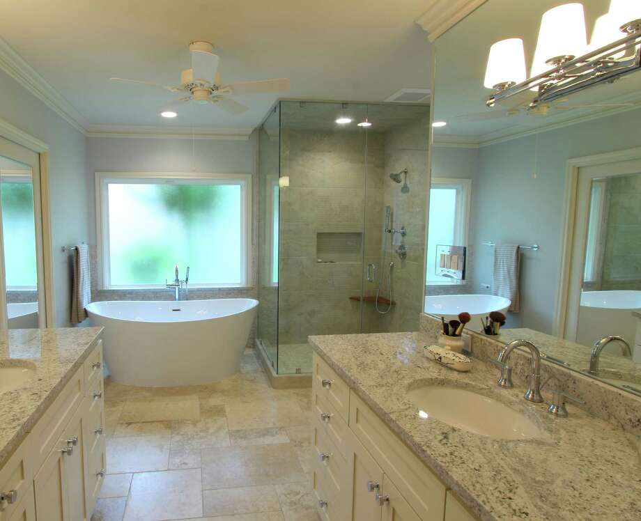 This master bath remodel boasts luxurious amenities.