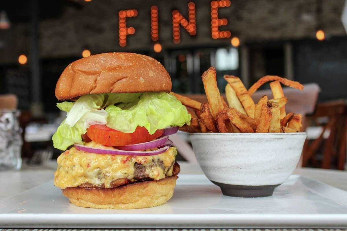 Low Country Burger with pimento cheese, kale, crispy guanciale and hand-cut fries from Bradley's Fine Diner in Houston.