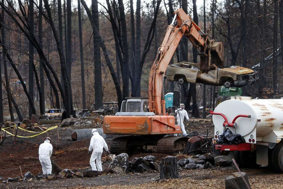 Workers from the Department of Resources, Recycling and Recovery clean up a Cobb homesite burned by the Valley Fire. Photo: Scott Strazzante, The Chronicle