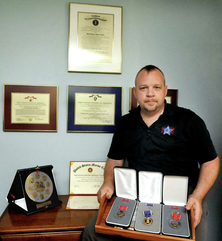 Brookfield resident Michael Zacchea is surrounded by awards from his tour of military duty. He will be Sen. Richard Blumenthal's guest at the State of the Union address on Jan. 12. Photo: Michael Duffy / Michael Duffy / The News-Times