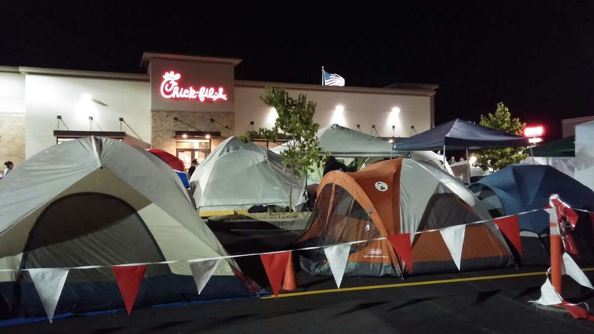 Campers wait for the opening of a new Chick-fil-A.