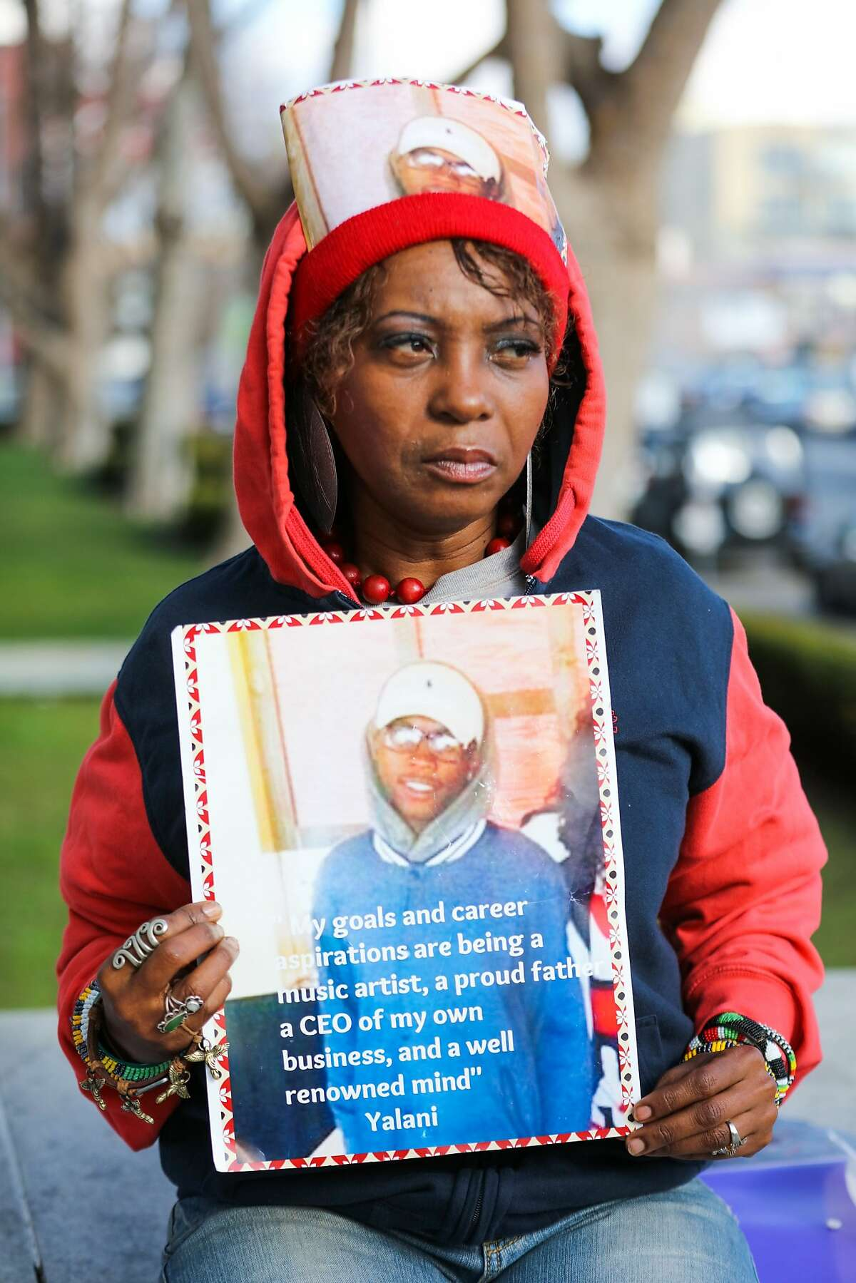 Salahaquekyah Chandler, the mother of Yalani Chinyamurindi, 19, who was killed in a quadruple homicide last year, holds an image of her son, in San Francisco, California on Thursday, January 7, 2016.