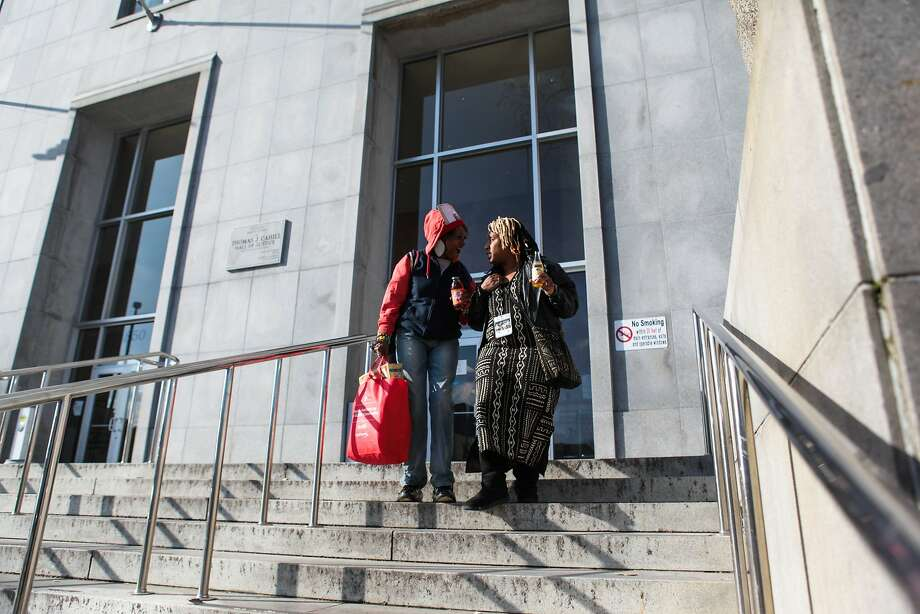 Salahaquekyah Chandler (left) walks out of the Hall of Justice with friend Toni Hunt- Heins (right), in San Francisco on Jan. 7, 2016. Chandler is the mother of Yalani Chinyamurindi, 19, who was killed in a quadruple homicide last year. She attended a meeting with the district attorney's head of homicide, who confirmed that there were no leads in her son's case. Photo: Gabrielle Lurie, Special To The Chronicle