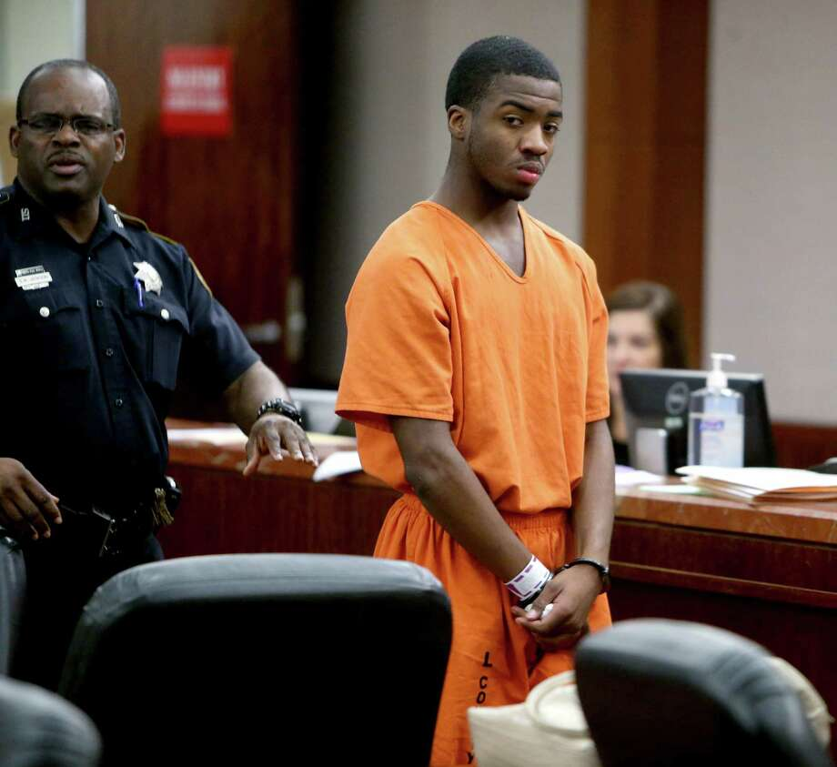 Eligah Haywood, an 18-year-old high school football player at Eisenhower, makes a first appearance in the 228th State District Court, charged with capital murder in the shooting death of Adrian Neal, 26, in the Harris County Criminal Justice Center Friday, Jan. 8, 2016, in Houston, Texas. Photo: Gary Coronado, Houston Chronicle / © 2015 Houston Chronicle