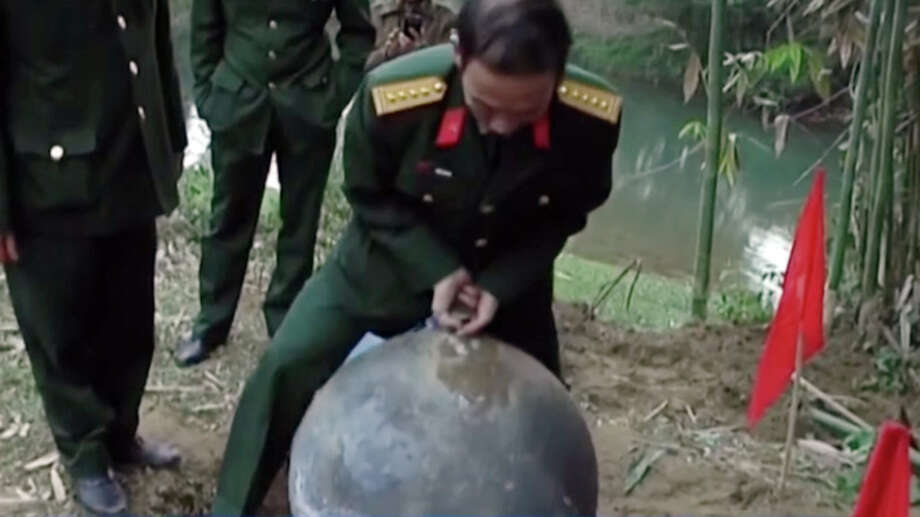 Vietnam's military is investigating three large metal balls, believed to be space junk, which landed in the country's remote north last weekend. Photo: VTV3