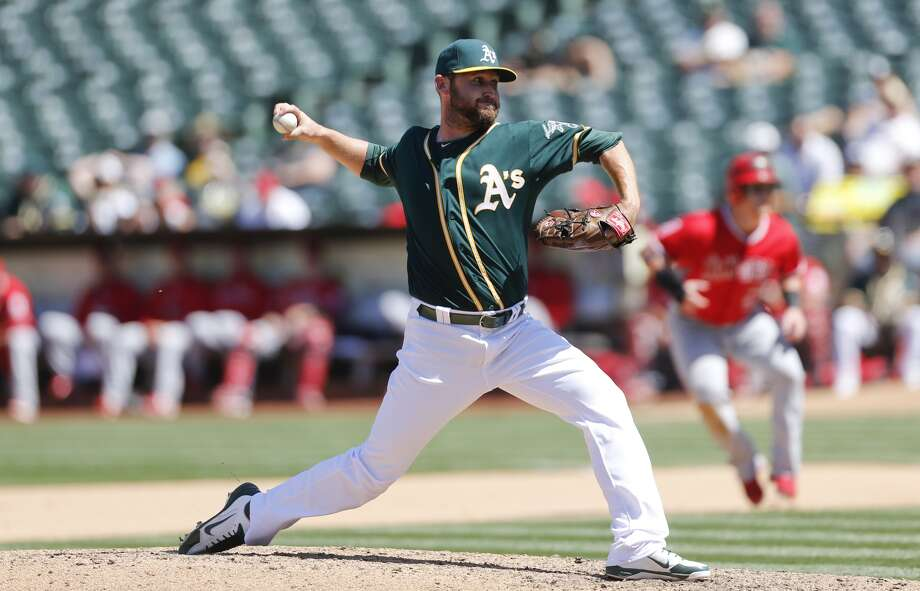 OAKLAND, CA - Ryan Cook #48 of the Oakland Athletics pitches during the game against the Los Angeles Angels of Anaheim at O.co Coliseum on April 30, 2015.  (Photo by Michael Zagaris/Oakland Athletics/Getty Images)