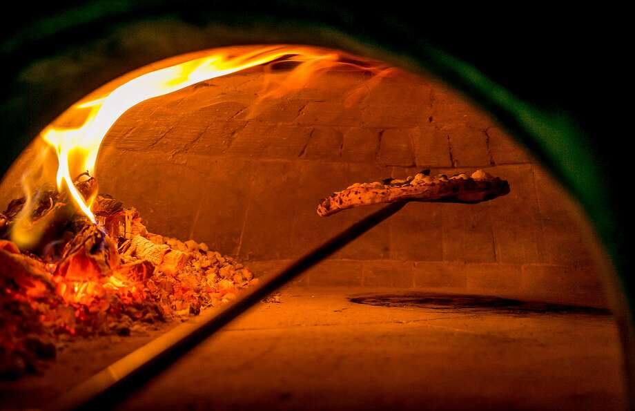 Pizza cooking in the oven at Del Popolo in San Francisco. Photo: John Storey, Special To The Chronicle