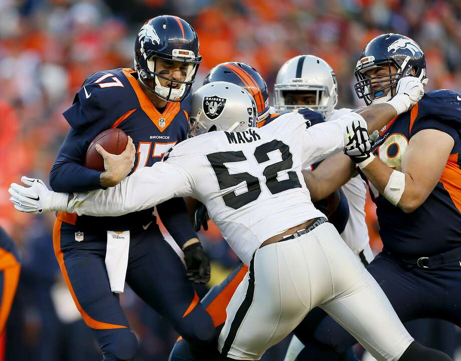 Oakland's Khalil Mack sacks Broncos quarterback Brock Osweiler in a Dec. 13 game in Denver. Mack had five sacks in the game and finished the season with 15, the second most in the NFL this season. Photo: Joe Mahoney, Associated Press
