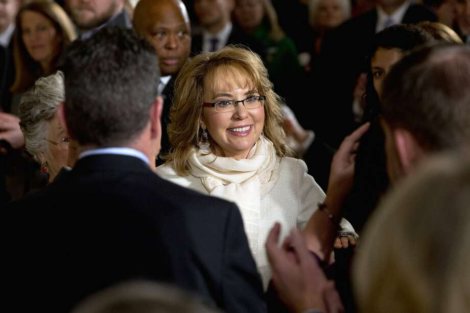 Former Arizona Rep. Gabby Giffords was present at the White House on Tuesday to hear President Obama announce steps his administration is taking to reduce gun violence. Photo: Jacquelyn Martin, Associated Press