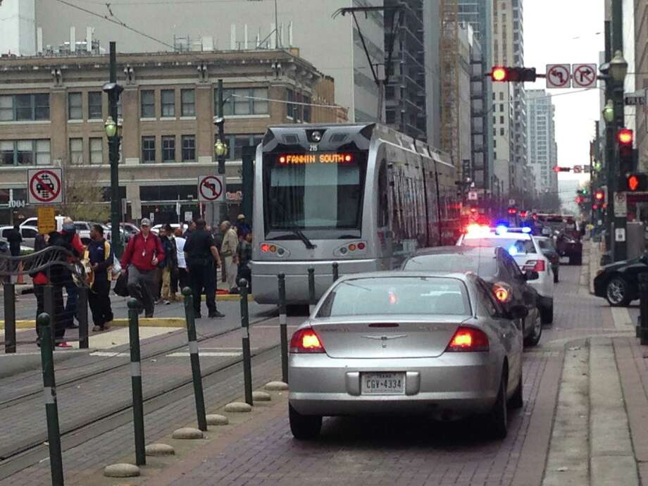A woman apparently escaped serious injury when she was bumped by a southbound train at Main and Preston, Jan 8, 2016. Photo: Frankie Ortega / Houston Chronicle