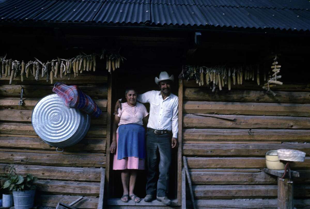 COPPER CANYON, MEXICO - NOVEMBER 1988: A Tarahumara couple at home in November 1988 in the Mexican city of Los Mochis in Sinaloa near the Sea of Cortez. Los Mochis is reachable via the Chihuaua al Pacifico Railroad, which represents one of the world's greatest engineering feats as it winds its way from Chihuaua through the Copper Canyon, also known as the series of canyons called Sierra Tarahumara. The Tarahumara culture is the most primitive aboriginal culture remaining in North America.