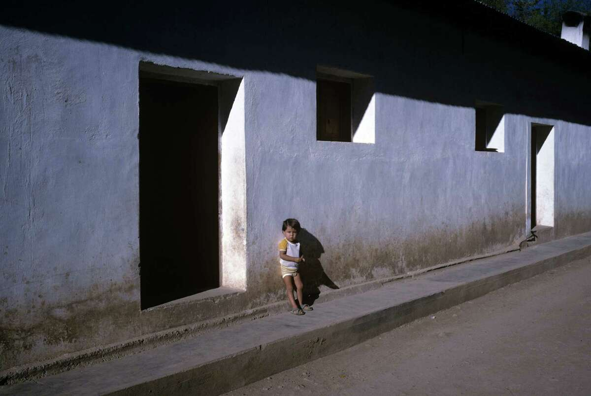A small child stands in front of his house in November 1988 in the Mexican city of Los Mochis in Sinaloa near the Sea of Cortez.