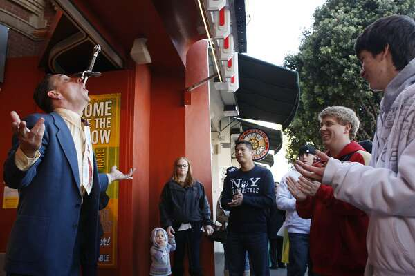 Matthew Bouvier swallows swords in honor of Sword Swallower's Day in front of Ripley's Believe it or Not in San Francisco Calif, on Saturday, Feb. 26, 2011.