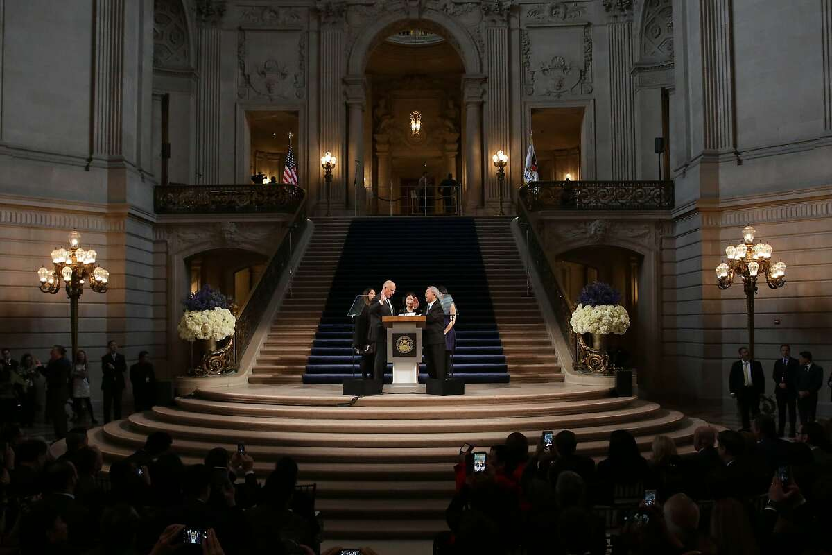 The Mayoral Oath of Office is administered to Mayor Ed Lee (front right) by Governor Jerry Brown (front left) in the rotunda as Tania Lee (back left to right), Anita Lee and Brianna Lee watch during the Inauguration of Mayor Ed Lee at City Hall on Friday, January 8, 2015 in San Francisco, Calif.