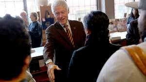 Former president Bill Clinton visits with supporters at Elliott Bay Book Company in Seattle on January 8, 2016.