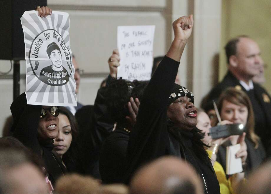 Protesters hold signs and call out during the Inauguration of Mayor Lee  at City Hall on Friday, January 8, 2015 in San Francisco, Calif. Photo: Lea Suzuki, The Chronicle