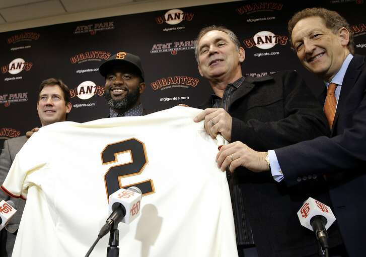 With general manager Bobby Evans, (left) manager Bruce Bochy, (right center) and CEO President Larry Baer, (right) the San Francisco Giants introduce their new outfielder Denard Span, in San Francisco, Calif., on Fri. January 8, 2016.