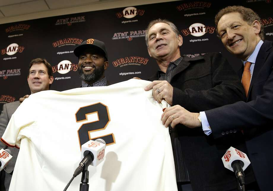 With general manager Bobby Evans, (left) manager Bruce Bochy, (right center) and CEO President Larry Baer, (right) the San Francisco Giants introduce their new outfielder Denard Span, in San Francisco, Calif., on Fri. January 8, 2016. Photo: Michael Macor, The Chronicle