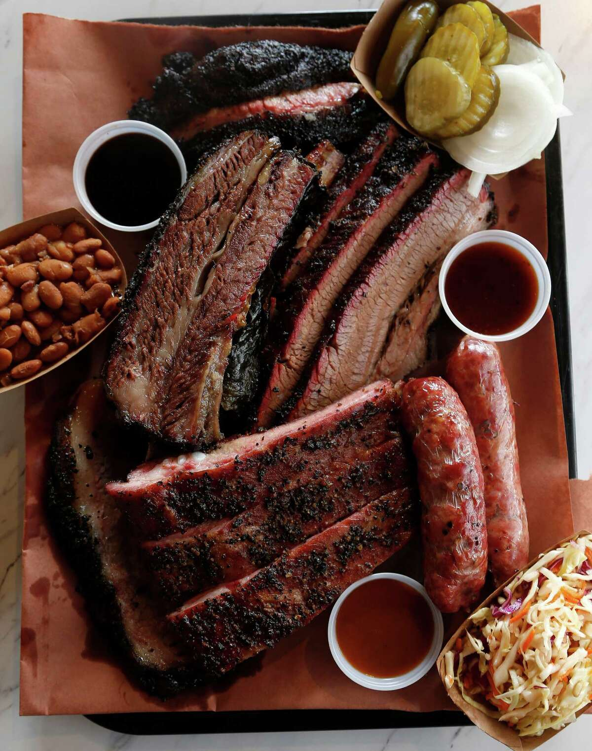 The 6-meat plate on butcher paper at Killen's Barbecue.