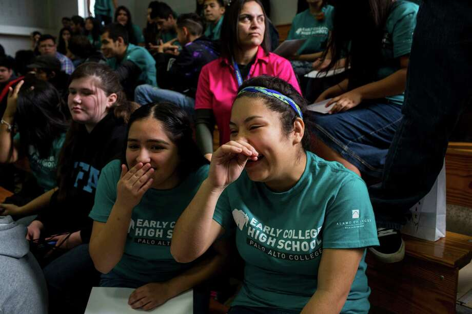 Stefany Guel, left, and Venus Sanchez laugh as they try to find their classmates in the crowd of nearly 500 high school students during Palo Alto College's first-ever New Student Convocation for high school freshmen enrolled at one of the college's five early college high schools in San Antonio, Texas on January 8, 2016. Photo: Carolyn Van Houten / Carolyn Van Houten / 2016 San Antonio Express-News