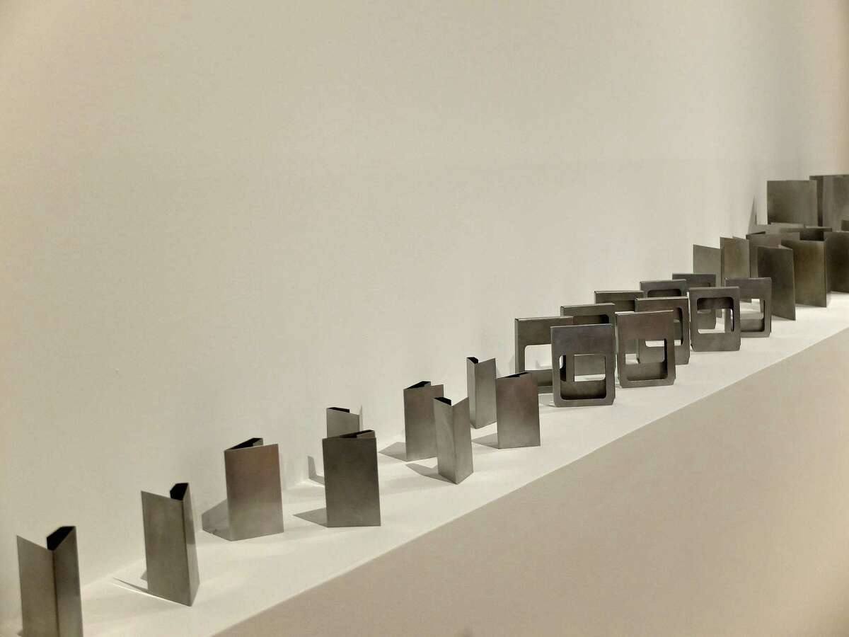 """Sculptures in Jennie C. Jones mid-career survey, """"Compilation,"""" include a collection of small works that mimic containers for audio cassettes, albums and other out-moded listening objects."""