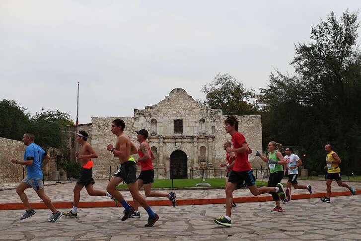 Participants pass the Alamo during the Rock 'n' Roll Marathon in San Antonio.