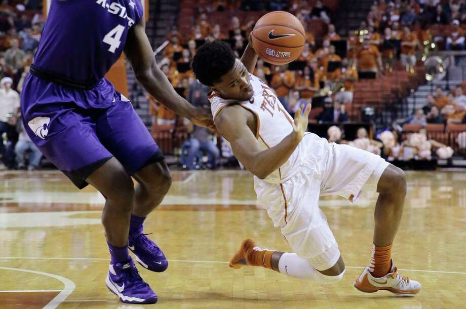 Texas guard Isaiah Taylor is fouled by Kansas State forward D.J. Johnson as he drives to the basket during the second half on Jan. 5 in Austin. Photo: Eric Gay /Associated Press / AP
