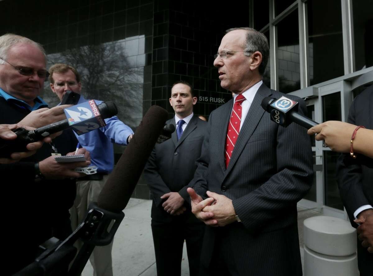 United States Attorney Kenneth Magidson, right, speaks to members of the media in front of the Bob Case United States Courthouse at 515 Rusk St., Friday, Jan. 8, 2016, in Houston. ( Jon Shapley / Houston Chronicle )