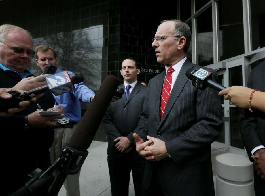 United States Attorney Kenneth Magidson, right, speaks to members of the media in front of the Bob Case United States Courthouse at 515 Rusk St., Friday, Jan. 8, 2016, in Houston. ( Jon Shapley / Houston Chronicle ) Photo: Houston Chronicle