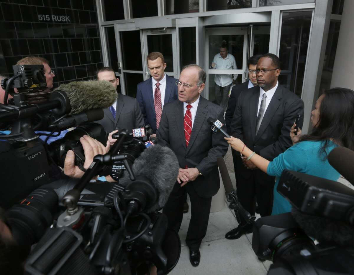 United States Attorney Kenneth Magidson, center, speaks to members of the media in front of the Bob Case United States Courthouse at 515 Rusk St., Friday, Jan. 8, 2016, in Houston. ( Jon Shapley / Houston Chronicle )
