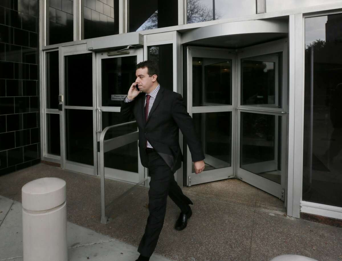 Christopher Correa leaves the Bob Case United States Courthouse at 515 Rusk St., Friday, Jan. 8, 2016, in Houston. Correa plead guilty to five counts of unauthorized access to computer information. ( Jon Shapley / Houston Chronicle )