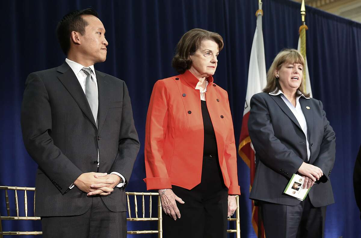 Feinstein said Apple is wrong to refuse to cooperate with the federal government to help unlock an iPhone used by terrorists in the San Bernardino massacre. In thisJan. 8, 2015 file photo,assembly member David Chiu (left) and senator Dianne Feinstein (middle) attend theswear in of sheriff-elect Vicki Hennessy (right) at city hall in San Francisco.