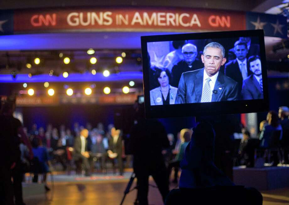 President Barack Obama is seen on a television monitor as he answers questions during a CNN televised town hall meeting at George Mason University in Fairfax, Va., Thursday, Jan. 7, 2016. Photo: Pablo Martinez Monsivais / Associated Press / Associated Press