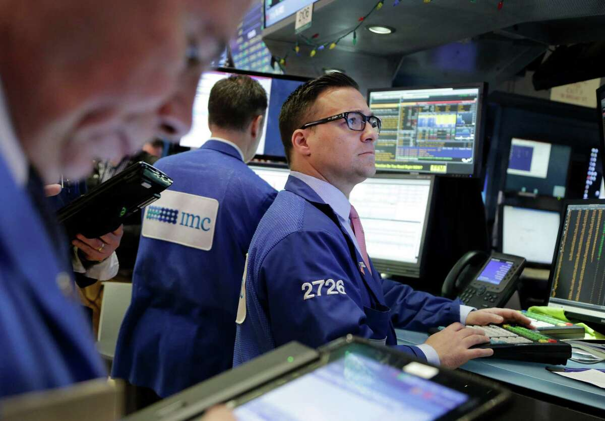 Traders work at the New York Stock Exchange, Friday, Jan. 8, 2016. A rebound in Chinese stocks helped shore up the mood in global stock markets Friday in the run-up to U.S. jobs data. (AP Photo/Mark Lennihan) ORG XMIT: NYML105