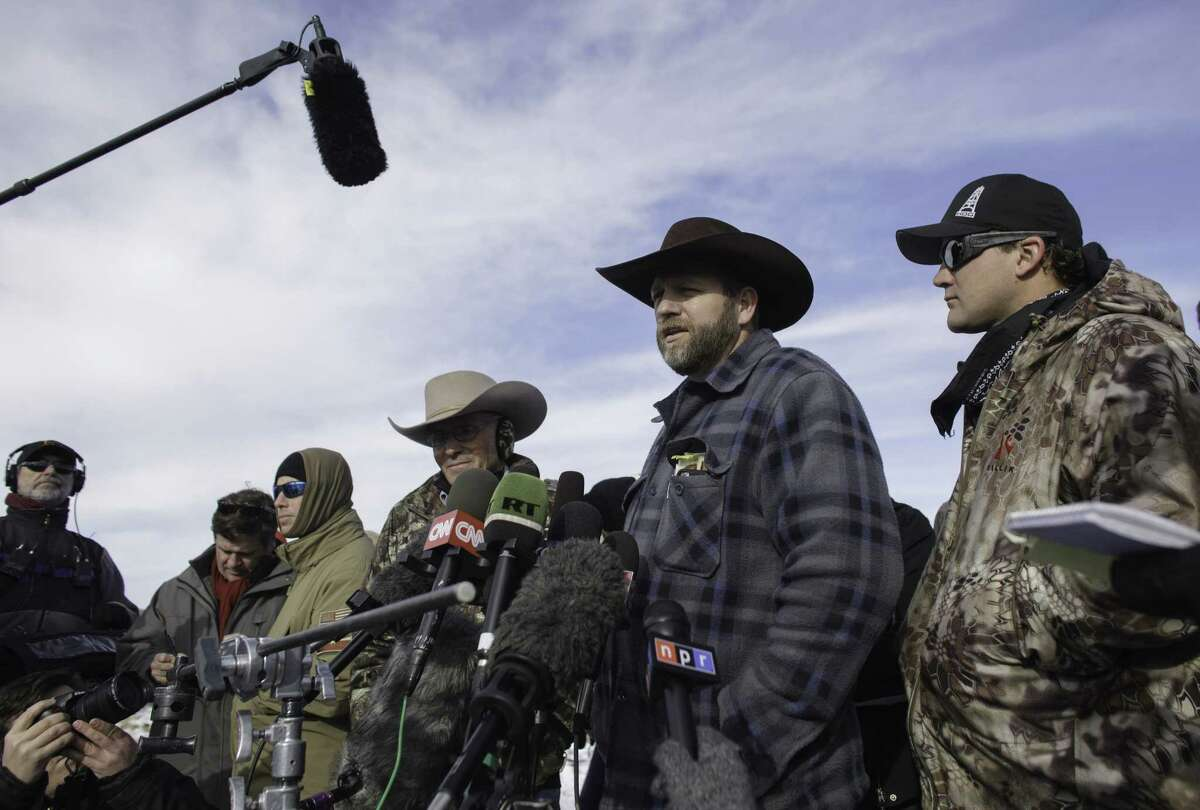 Ammon Bundy talks with the media at the Malheur National Wildlife Refuge Headquarters in Burns, Oregon. on January 6, 2016. The small group of armed activists holed up at a remote U.S. federal wildlife refuge have diverted