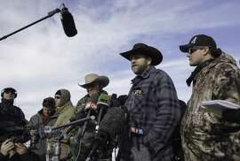"""Ammon Bundy talks with the media at the Malheur National Wildlife Refuge Headquarters in Burns, Oregon. on January 6, 2016. The small group of armed activists holed up at a remote U.S. federal wildlife refuge have diverted """"public attention and scrutiny away from the injustice that the federal government perpetrated"""" on two men who were sentenced twice for the same crime."""