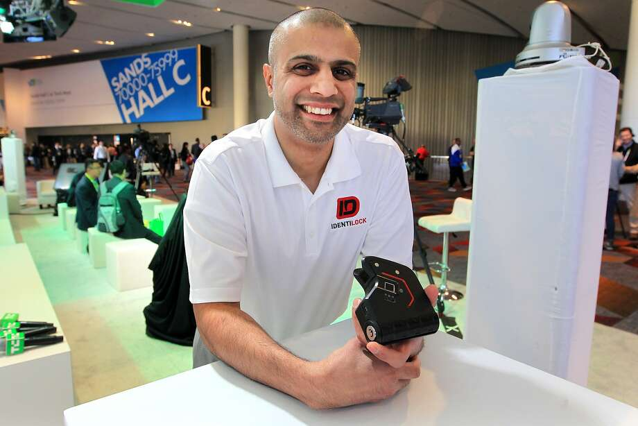 Omer Kiyani, founder of Sentinl, is seen with his biometric gun lock Identilock during CES at the Sands Expo Center Friday, Jan. 8, 2016, in Las Vegas. Sam Morris, Special to The Chronicle Photo: Sam Morris, Special To The Chronicle