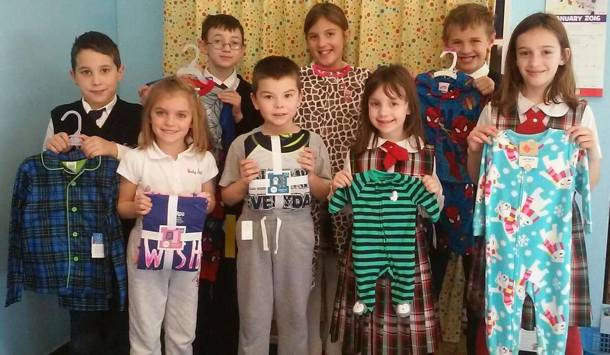 Students at Holy Spirit School in East Greenbush collected more than 60 brand new pajamas as part of Scholastic's Annual Great Pajama Drive, which were donated to St. Paul's Center for Homeless Families in Rensselaer. (Submitted photo)
