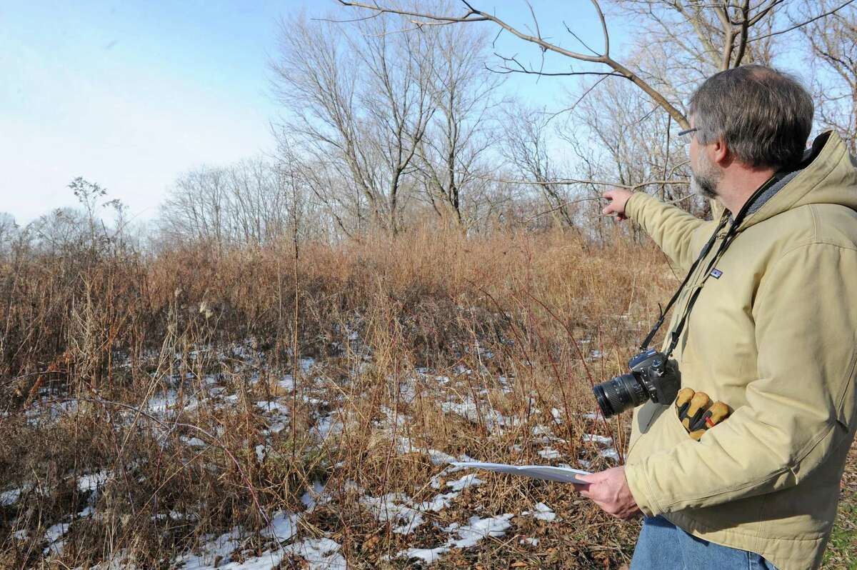 Mark King the executive director of the Mohawk-Hudson Land Conservancy tours a donated parcel of land off of River Road on Friday Jan. 8, 2016 in Latham, N.Y. Dr. Patricia Fox has donated 70 acres to the Mohawk-Hudson Land Conservancy to keep it forever wild. (Michael P. Farrell/Times Union)