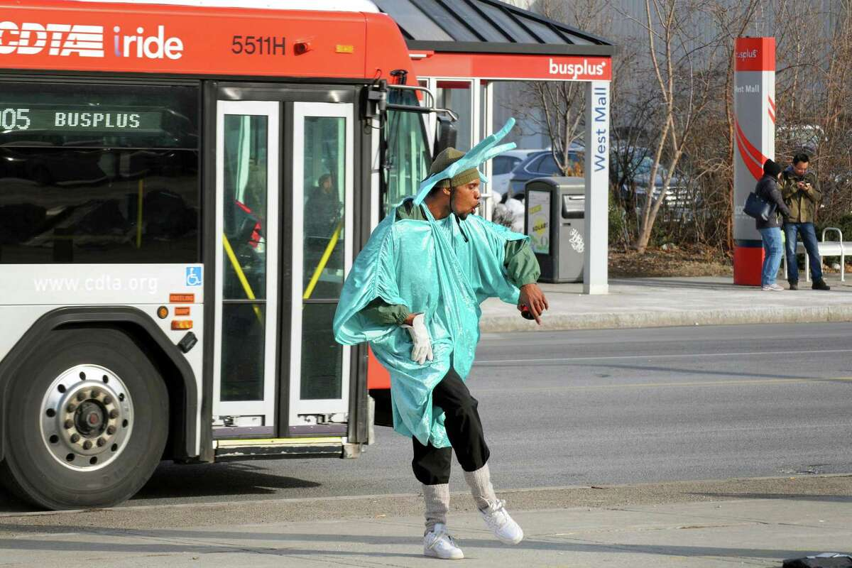 Abdul Trowell keeps warm by putting on a dance display for passing motorists while working for Liberty Income Tax Service on Central Avenue Friday Jan. 8, 2016 in Albany, N.Y. (Michael P. Farrell/Times Union)