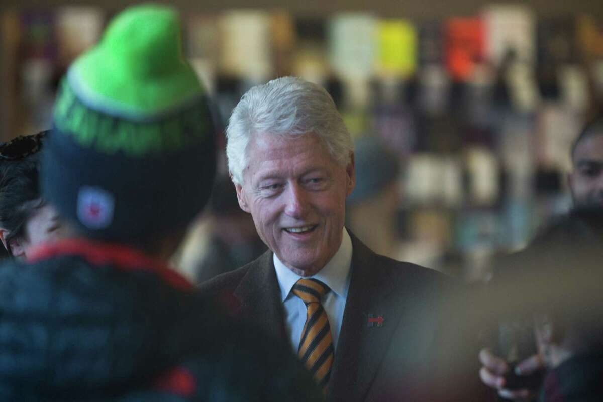 President Bill Clinton talks with the public at Elliot Bay Books while in town for a fundraiser for his wife, Hillary Clinton's, campaign at the Century Ballroom in Capitol Hill on Friday, Jan. 8, 2016.