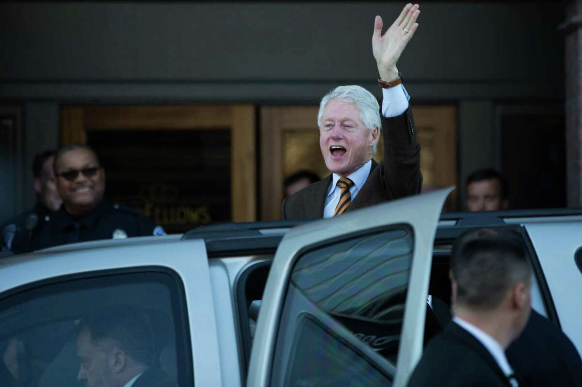 President Bill Clinton waves to the crowd following a fundraiser for his wife, Hillary Clinton's, campaign at the Century Ballroom in Capitol Hill on Friday, Jan. 8, 2016.