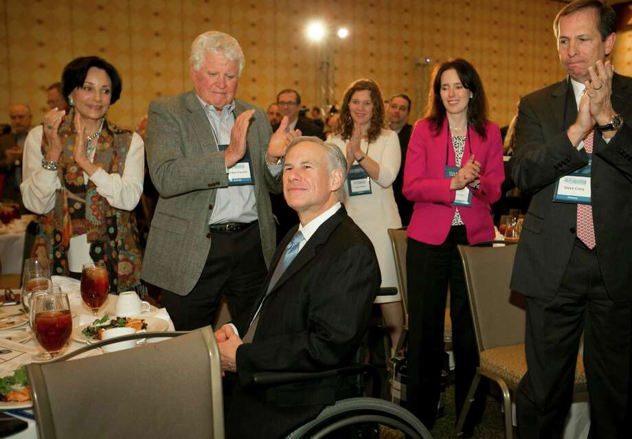 Gov. Greg Abbott gets a standing ovation after he called for a convention of states to amend the Constitution during a speech at the Texas Public Policy Foundation in Austin, Texas, Friday, Jan. 8, 2016. Abbott called on Texas to take the lead in pushing for constitutional amendments that would give states power to ignore federal laws and override decisions by the U.S. Supreme Court. (Jay Janner/Austin American-Statesman via AP) MANDATORY CREDIT Photo: Jay Janner, MBO / Associated Press / Austin American-Statesman