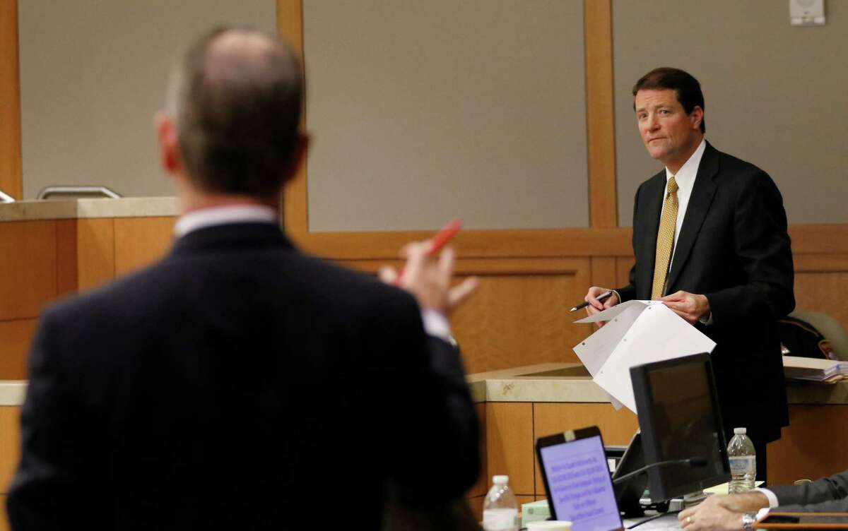 Bill Mateja, an attorney for Texas Attorney General Ken Paxton (right), argues with Special Prosecutor Brian Wice during a pre-trial motion hearing at the Collin County courthouse on Tuesday, Dec. 1, 2015, in McKinney, Texas.