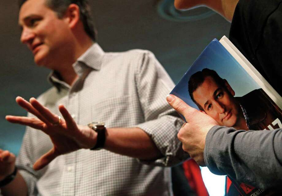 A woman holds a copy of a book by Republican presidential candidate, Sen. Ted Cruz, R-Texas, as she listens to Cruz speak after a town hall at Praise Community Church in Mason City, Iowa, Friday, Jan. 8, 2016. (AP Photo/Patrick Semansky) Photo: Patrick Semansky, STF / Associated Press / AP