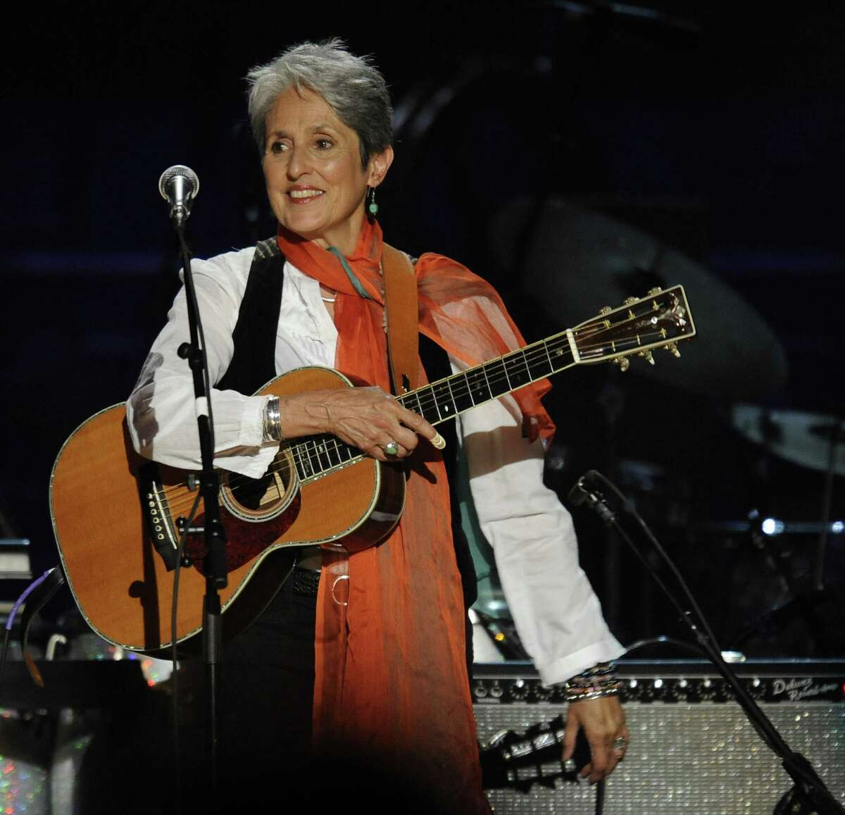 Joan Baez smiles during a concert for folk music legend Pete Seeger at Madison Square Garden in Nedw York on May 3, 2009 marking his 90th birthday. Proceeds from the show will go to Hudson River Sloop Clearwater, an organization founded by the singer 40 years ago to preserve and protect the Hudson River. AFP PHOTO/TIMOTHY A. CLARY (Photo credit should read TIMOTHY A. CLARY/AFP/Getty Images)