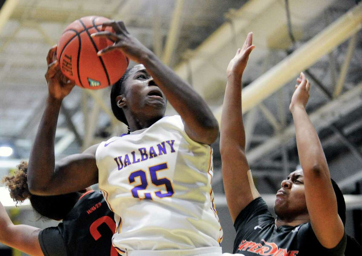 UAlbany's Shereesha Richards (25) drives to the basket against Pepperdine during the first half of an NCAA women's college basketball game on Sunday, Nov. 15, 2015, in Albany, N.Y. (Hans Pennink / Special to the Times Union) ORG XMIT: HP104