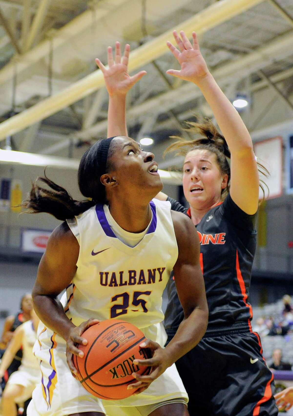 UAlbany's Shereesha Richards (25) drives to the basket against Pepperdine during the first half of an NCAA women's college basketball game on Sunday, Nov. 15, 2015, in Albany, N.Y. (Hans Pennink / Special to the Times Union) ORG XMIT: HP106